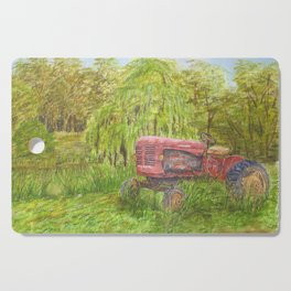 Old Massey Harris 55 tractor in rural France Cutting Board
