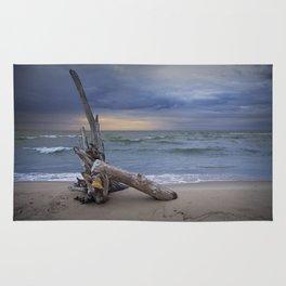 Sunrise on the Beach with Driftwood at Oscoda Michigan Rug