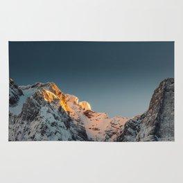 Last light before sunset on mountains Rug