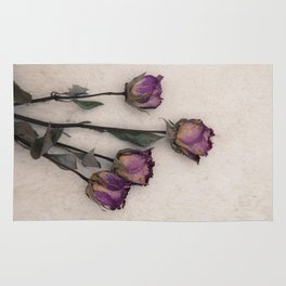 four dried roses Rug