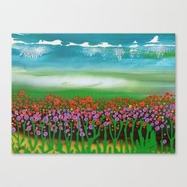 The meadow - A landscape in the background a blue sky and wildflowers Canvas Print