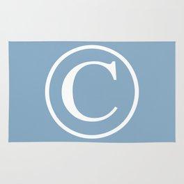 Copyright sign on placid blue background Rug