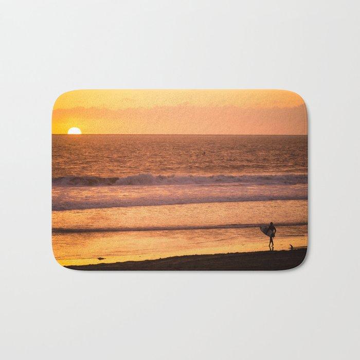 Surfer watching sunset in Southern California Bath Mat