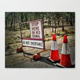 Stop on the red light - roadworks sign. Canvas Print
