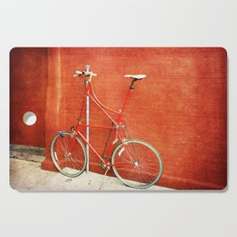 Red Tall Bike Against Brick Wall Cutting Board