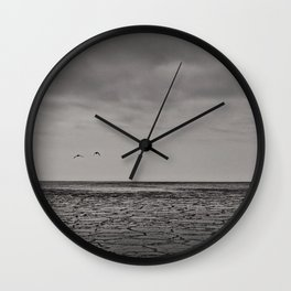 Two birds and a frozen sea Wall Clock