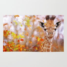 Young giraffe in colorful leaves, South Africa Rug