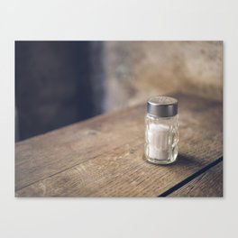 Salt shaker on a table kitchen food background Canvas Print