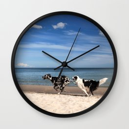 Playing dogs at the beach Wall Clock