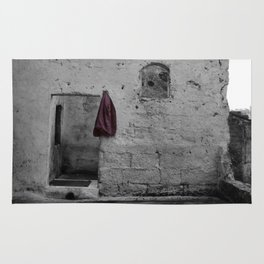 Sassi di Matera with red jacket Rug