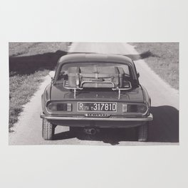 Triumph spitfire on a gravelly road in southern Italy, english sports car, fine art photography Rug