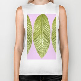 Three large green leaves on a pink background - vivid colors Biker Tank
