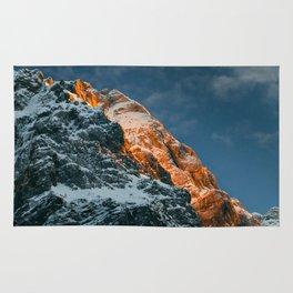 Glowing mountain at sunset Rug