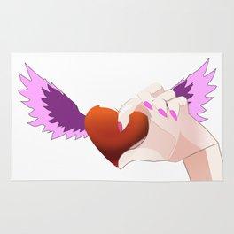A hand catching a Heart Rug