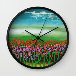 The meadow - A landscape in the background a blue sky and wildflowers Wall Clock