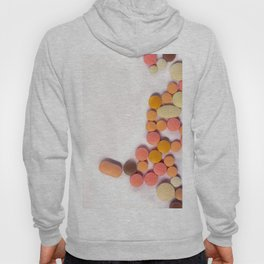 Numerous colorful pills on white background. Hoody