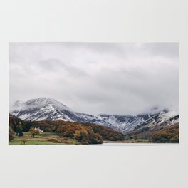 Crummock Water, with snow covered fells. Cumbria, UK. Rug