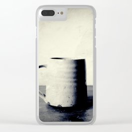 Cup of coffee on a table Clear iPhone Case