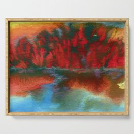 Red trees over blue water Serving Tray