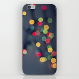 Blurred background with multicolored lights of garland iPhone Skin