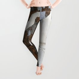 rusty orange wall with poster shreds Leggings
