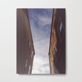 between some buildings Metal Print