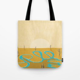 A stream of water in warm yellow desert Tote Bag