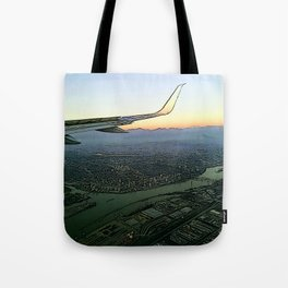 Landing together with the sun Tote Bag