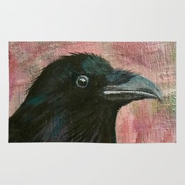 Raven rising against a pink sunset Rug