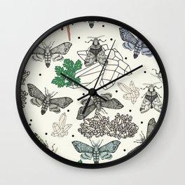 Moths and rocks. Wall Clock