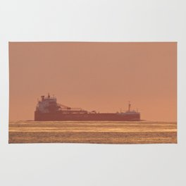 Ship under Copper Sunset Lightning Rug