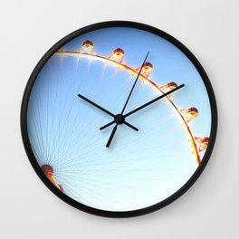 orange Ferris Wheel in the city with blue sky Wall Clock