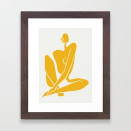 Sitting nude in yellow Framed Art Print