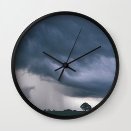 Evening thunder storm and clouds over rural scene. West Acre, Norfolk, UK. Wall Clock
