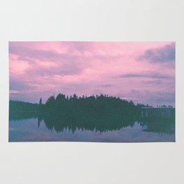 Rose island sunsets Rug