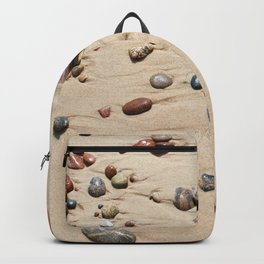 Wet sand and stones on beach Backpack