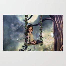 Cute little fairy with kitten on a swing Rug