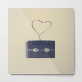 Retro black music cassette and heart shaped tape on beige background Metal Print