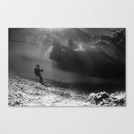 diver looking up, under thew boat Canvas Print