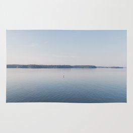 Bird Flying Over Serene Lake Barkley Rug
