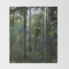 Green forest shrouded the sun. Throw Blanket