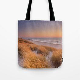 Dunes and beach at sunset on Texel island, The Netherlands Tote Bag