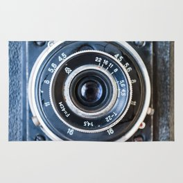 Photo lens of the old Soviet camera. Rug