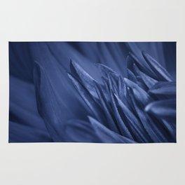 Macro photo of a blue flower Rug