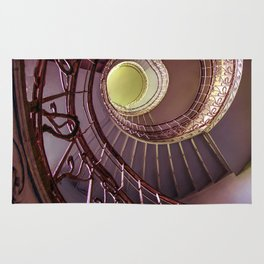 Spiral staircase in red and golden tones Rug