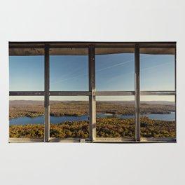 through the firetower window Rug