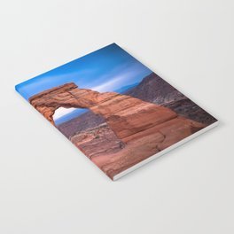 Delicate - Delicate Arch Glows on Rainy Day in Utah Desert Notebook