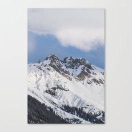 Clouds roll over the snow covered mountains of Innsbruck in Austria. Canvas Print