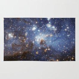 LH 95 stellar nursery in the Large Magellanic Cloud (NASA/ESA Hubble Space Telescope) Rug