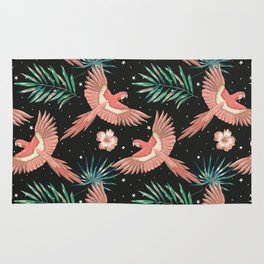 Pink macaw parrots on the starry night sky Rug